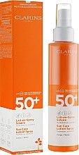 Parfüm, Parfüméria, kozmetikum Napvédő testápoló tej spray-ben - Clarins Lait-en-Spray Solaire Corps 50+